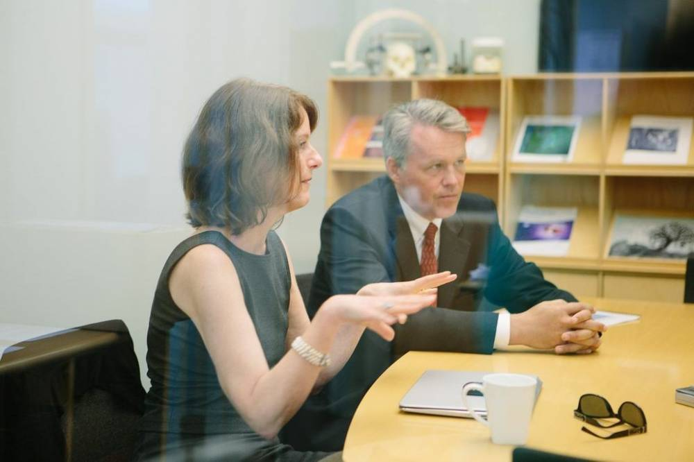 Denice Spero, Ph.D.,  left, and Dr. Lars Wahlberg, discuss plans to bring their brain repair technology into clinical use.