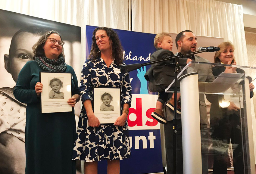 Representative-elect Rebecca Kislak, left, and Rep. Teresa Tanzi, second from left, join other recipients of the Covering Kids awards on stage at the Rhode Island Kids Count luncheon celebrating children's health, held on Nov. 19.