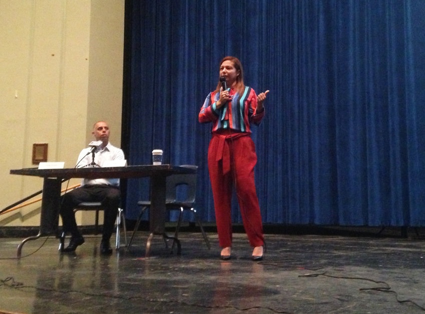 Angelica Infante-Green, right, commissioner of Rhode Island schools, opens a listening session at Hope High School with an extended monologue, Providence Mayor Jorge Elorza, left, spoke first.