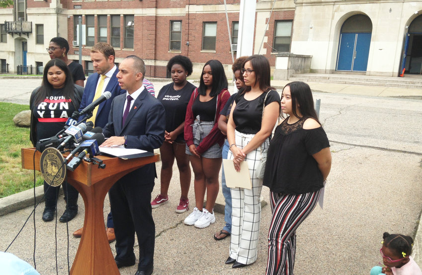 Providence Mayor Jorge Elorza addresses the news media at a news conference held on July 19 in front of Hope High School.