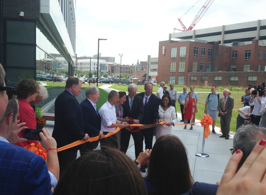 The ceremonial cutting of the ribbon to open the Wexford Innovation Complex on July 17.