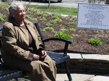 Author Toni Morrison seated on the bench dedicated in 2009 on the Oberlin, Ohio, town green in memory of all those former slaves who traveled through Oberlin on the Underground Railroad.
