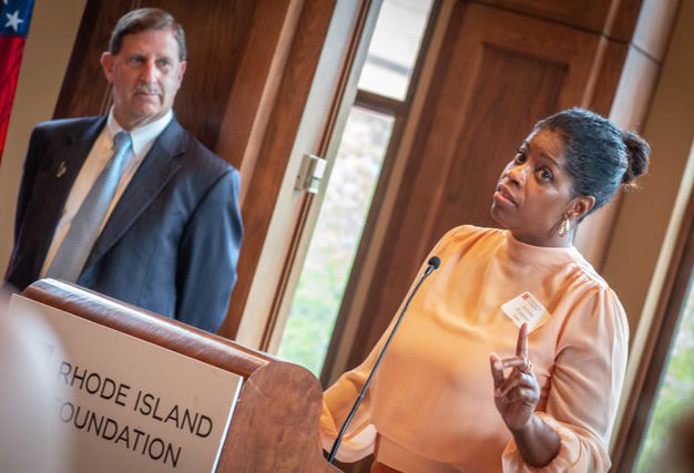 Womazetta Jones, right, the new Secretary of the R.I. Executive Office of Health and Human Services, speaking at a reception to welcome her on Thursday morning, Aug. 22, at the Rhode Island Foundation, with Neil Steinberg, president and CEO of the Rhode Island Foundation.