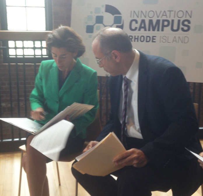Gov. Gina Raimondo, left, and Stefan Pryor, CommerceRI secretary, confer in advance of news event to announce the latest two awards for the creation of innovation campuses with URI.