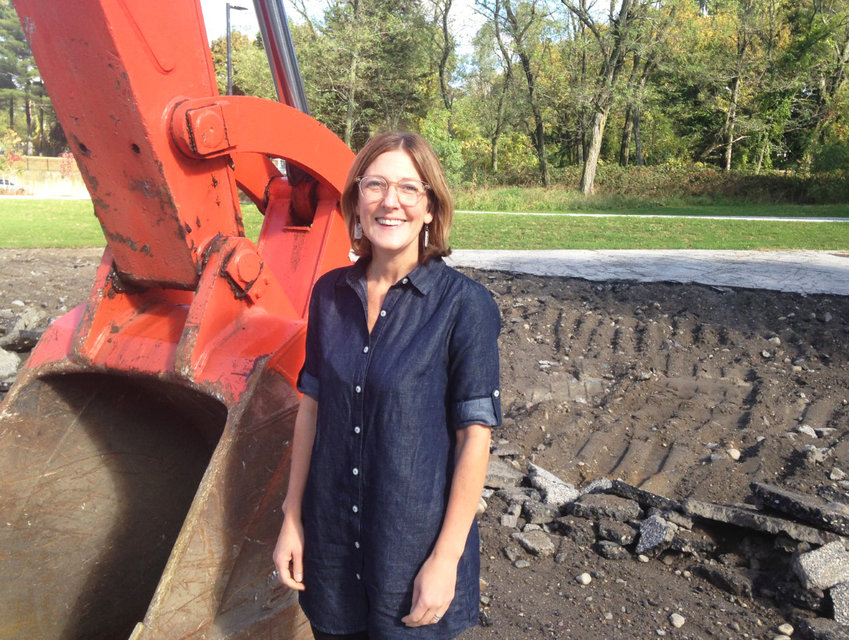 Jennifer Hawkins, executive director of ONE Neighborhood Builders, at the construction site in Olneyville where five new small homes will be built, ready for occupancy next fall.