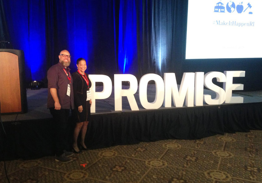 """R.I. Education Commissioner Angelica  Infante-Green poses for a photograph in front of a """"Promise"""" sign at the Rhode Island Foundation """"Make It Happen RI"""" gathering in December of 2019."""