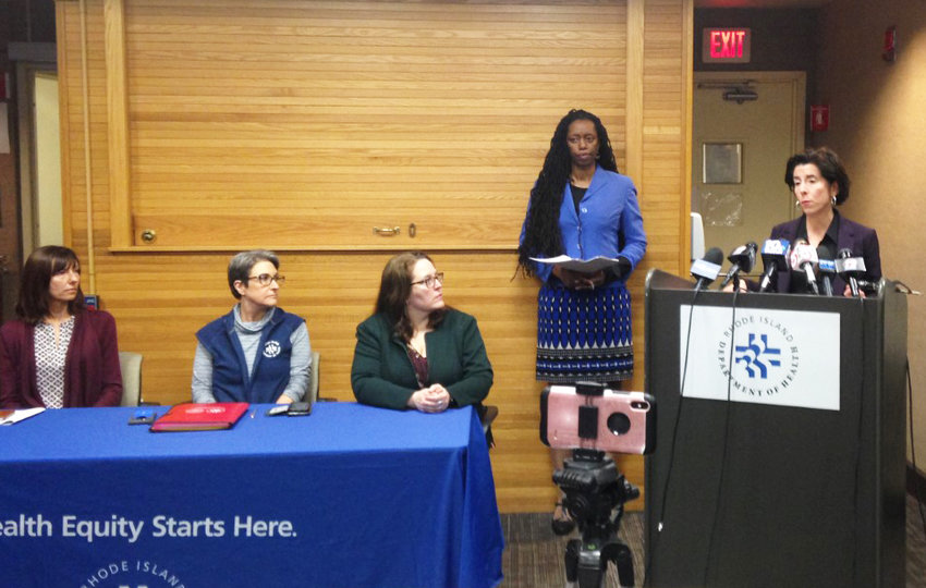 "Gov. Gina Raimondo addresses a hastily called news conference on Sunday afternoon, March 1, after the first ""presumptive"" case of coronavirus was diagnosed in Rhode Island. Dr. Nicole Alexander-Scott, director of the R.I. Department of Health, stands behind the Governor."
