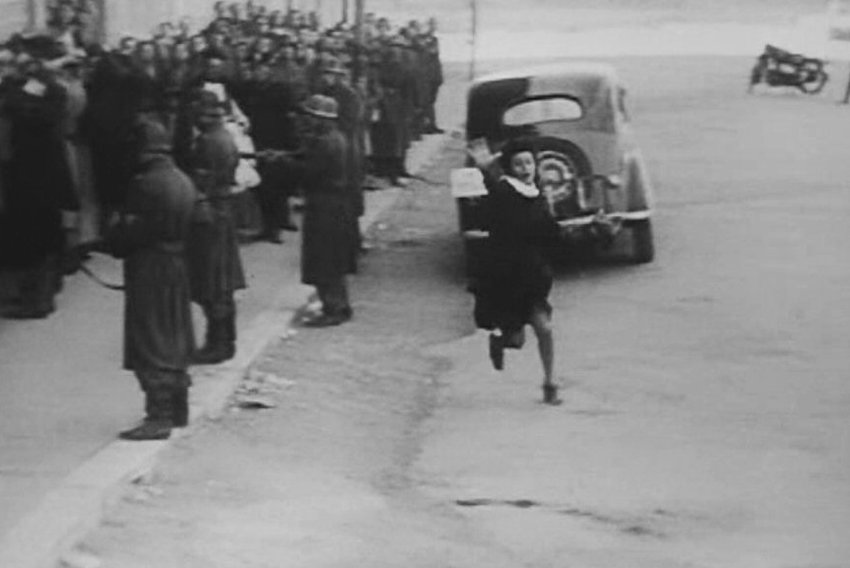 """In a pivotal scene from """"Open City,"""" the character Anna attempts to prevent the arrest of a partisan, only to be shot and killed by German troops."""