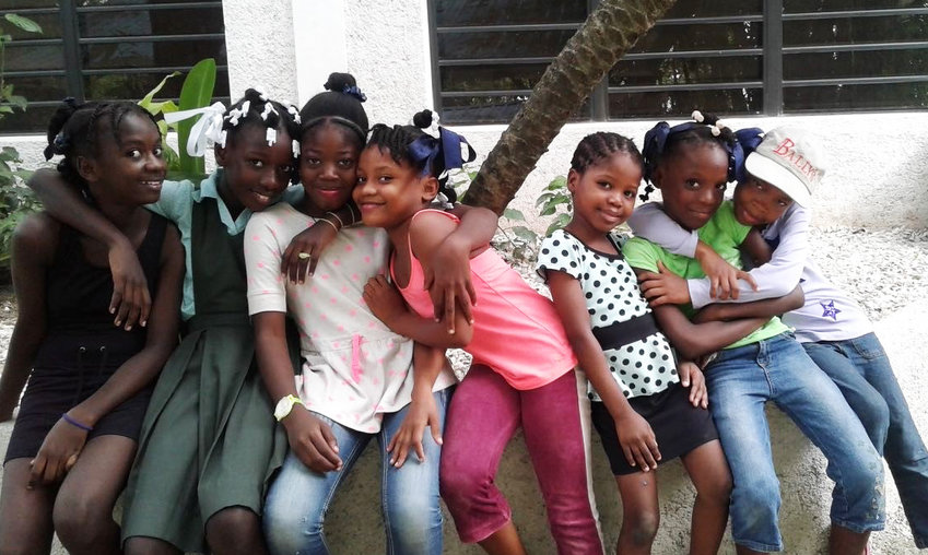 "Girls at YWCA Haiti, whose motto is: ""Change starts with me."""