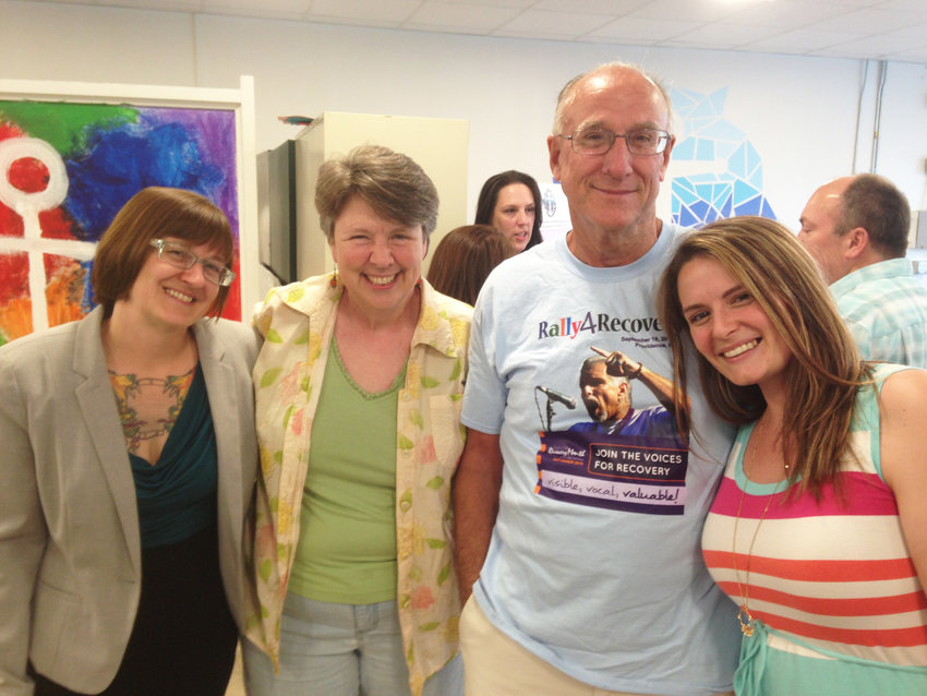 Ian Knowles, third from left, at the June 2018 opening of the Jim Gillen Teen Center, posing with the extended family of RICARES, including Monica Smith, Michelle McKenzie, and Abbie Stenberg