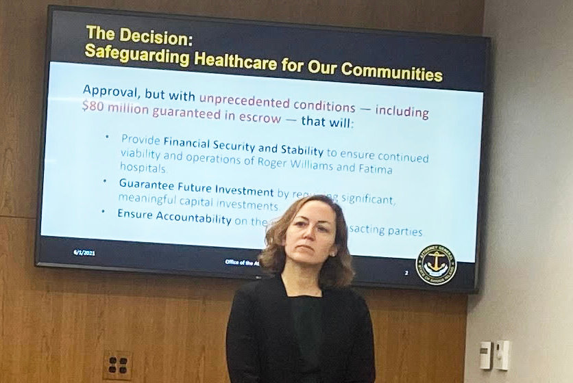 One of the slides at the June 1 news conference held by R.I. Attorney General Peter Neoronha, announcing the decision to approve the transfer of ownership at Prospect Medical Holdings, with the condition of an $80 million escrow, with Adi Goldstein, the deputy attorney general, in the foreground.