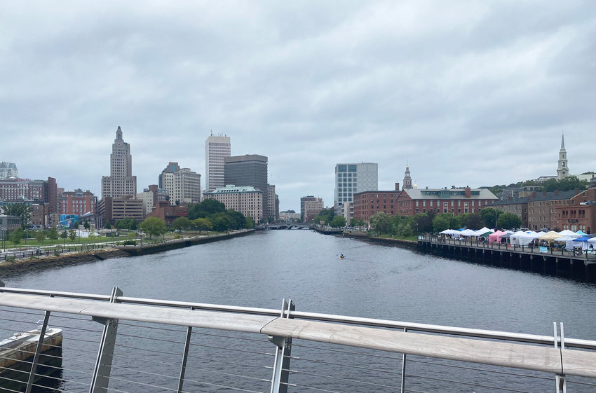 The forecast from the pedestrian bridge in Providence: rising waters threaten the river walk through downtown Providence, a consequence of climate change.