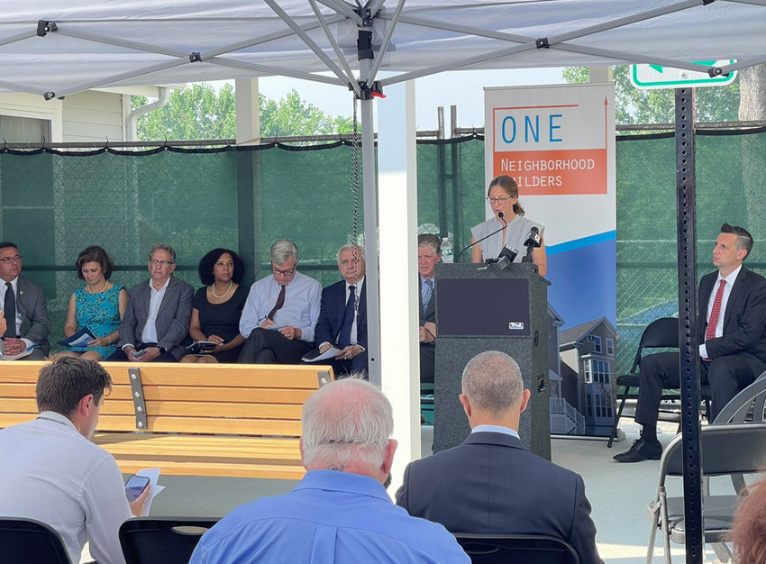 Jennifer Hawkins, executive director of ONE Neighborhood Builders, addresses the attendees at the celebration on July 26 of two affordable housing projects.