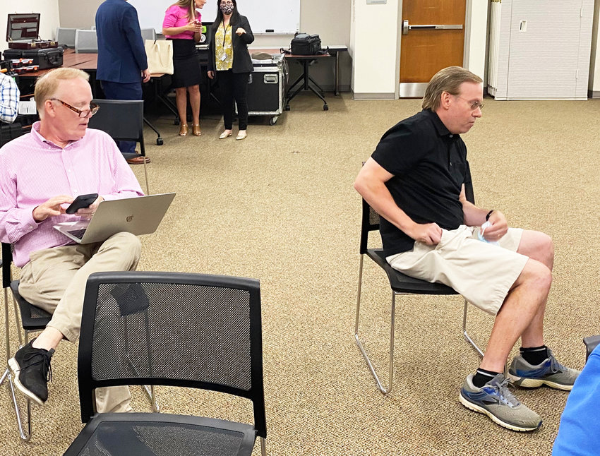 Jim Hummel, left, and John DePetro, were among the unmasked reporters at the Aug. 10 news conference held by the McKee administration.