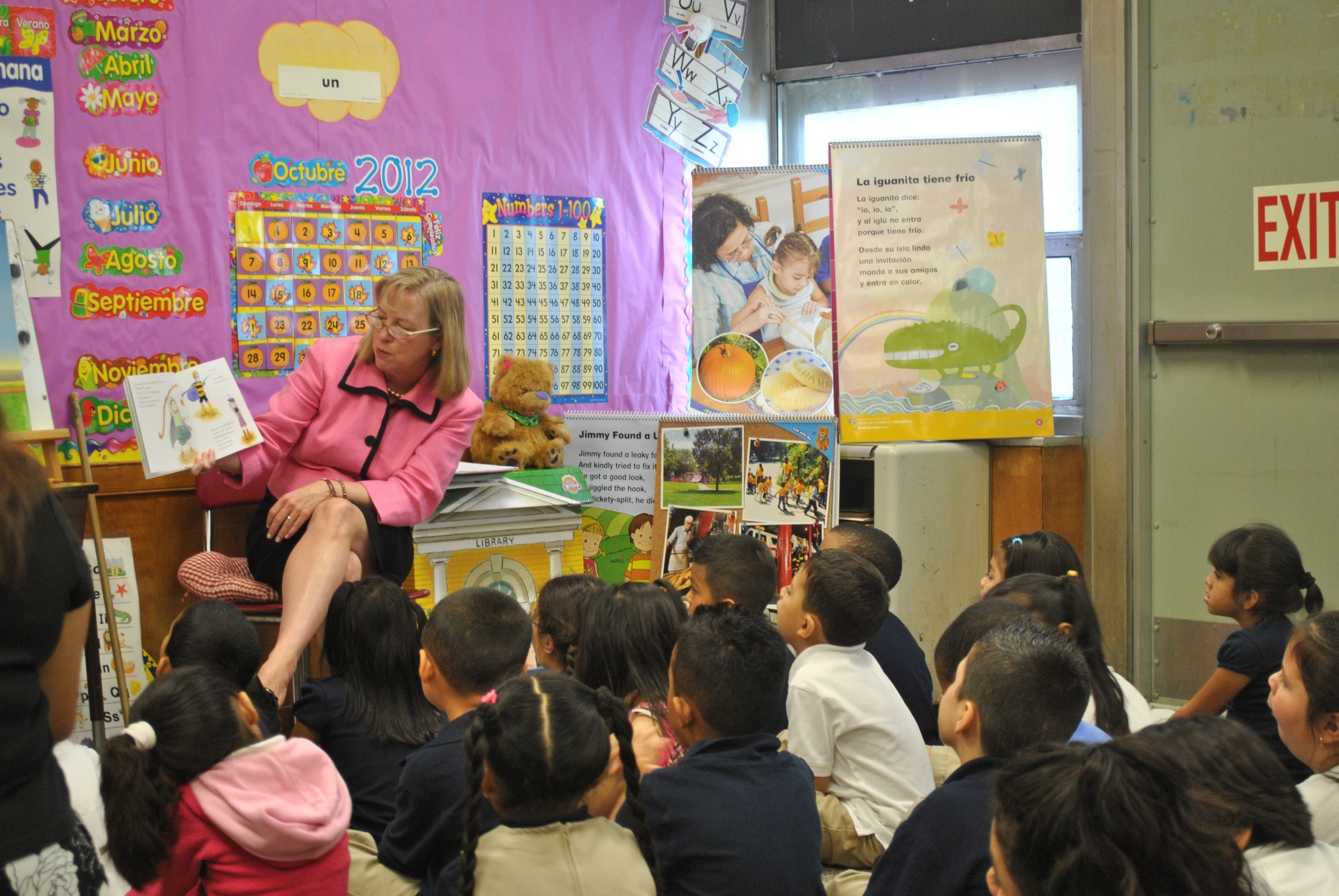 Elizabeth Burke Bryant, executive director of Rhode Island KIDS COUNT, reading to to a class at the William D'Abate Elementary School in Providence. As a result of the federal sequester, Rhode Island is losing almost 400 seats in Head Start this year.