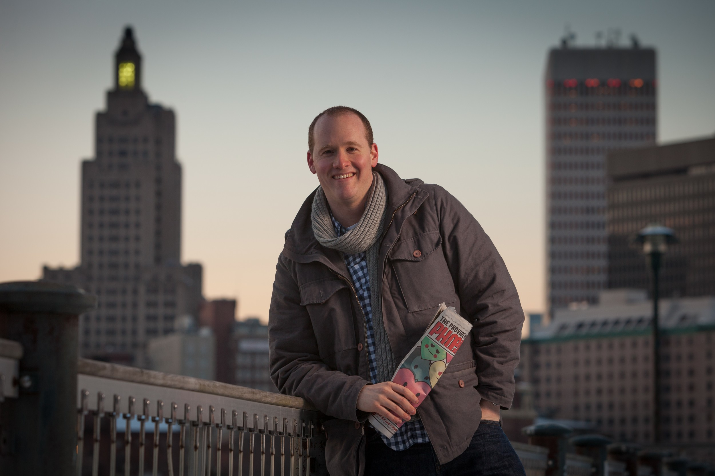 Phil Eil, the news editor at the Providence Phoenix, with the skyline of Providence at sunset behind him. Eil discusses his views about the conversation that Rhode Island needs to engage in.