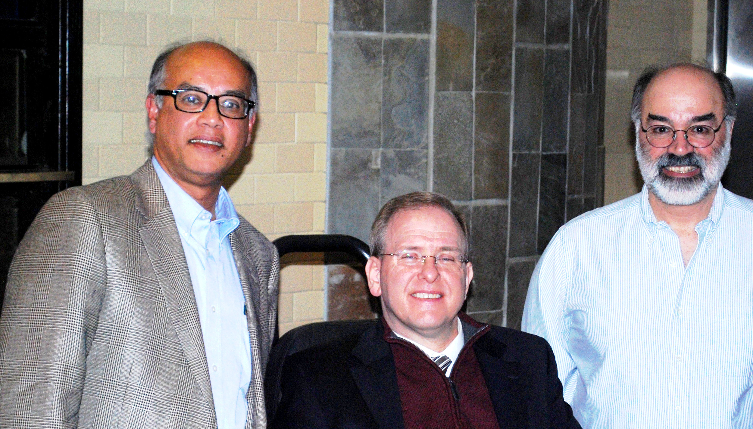 Kollol Pal, CEO of Mnemosyne, Rep. Jim Langevin, and Frank Menniti, chief science officer of Mnemosyne, at a recent meeting to discuss the company's efforts to develop new therapeutic approaches for traumatic brain injry and post-traumatic stress disorder.