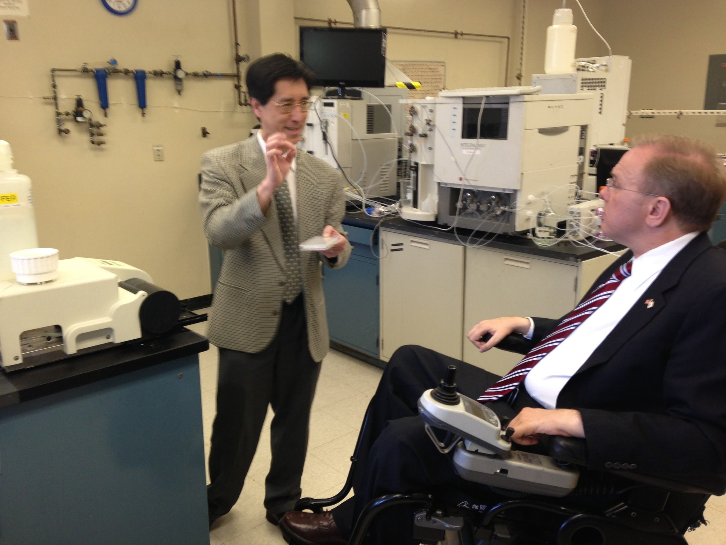 Dr. Yow-Pin Lim talks with Rep. Jim Langevin at ProThera Biologics' new commercial lab facility at the former Fuji Film building, where Slater Technology Fund has created a commercial lab incubator.