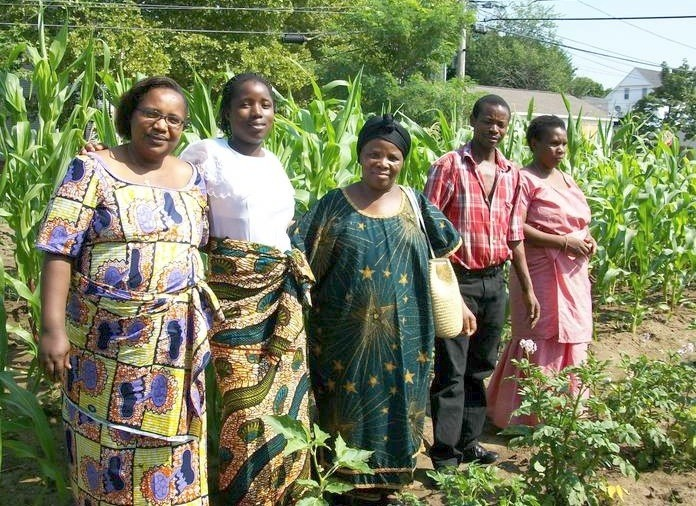 Marie Mukabahizi, left, Jeanette, Ada and Elijah at St. Michael's community garden.