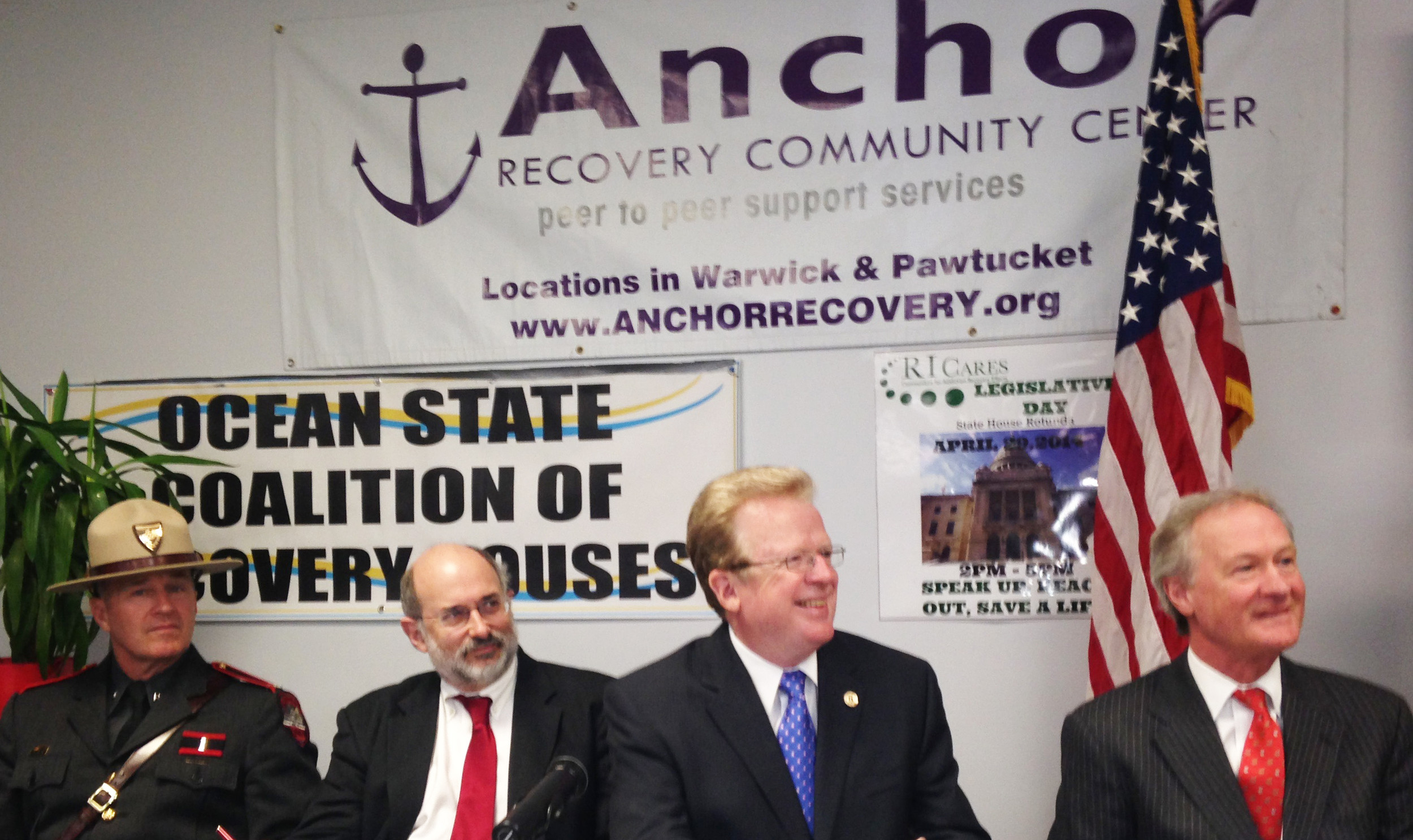 R.I. State Police Colonel Steven O'Donnell, R.I. Department of Health Director Dr. Michael Fine, Craig Stenning, director of the R.I. Department of Behavioral Healthcare, Developmental Disabilities and Hospitals, and Gov. Lincoln Chafee at a new conference in April at the Anchor Recovery Community Center in Pawtucket.