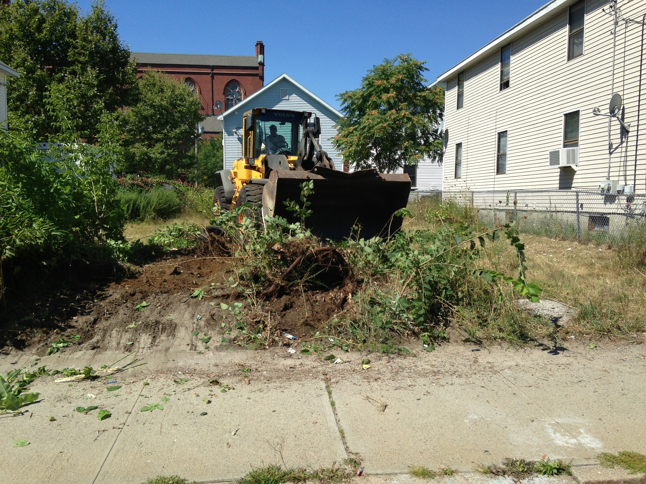A vacant lot at 433 Prairie Ave. in Providence is cleared to make way for a new urban greenhouse, part of the Lots of Hope initiative to support local urban farming.