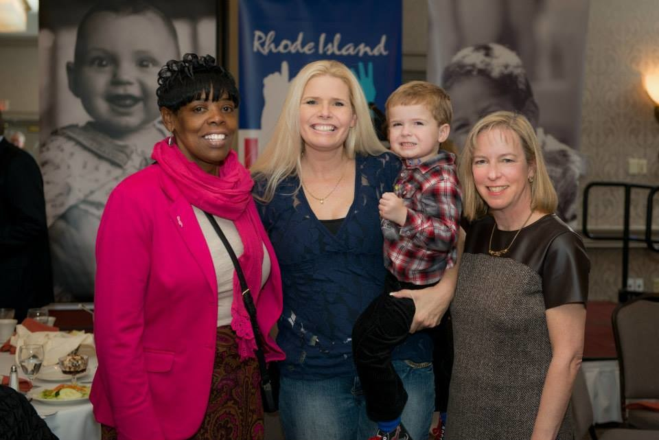 From left: Jackie Dowdy, from Neighborhood Health Plan of Rhode Island, Serena Simeone and her son, Braden, and Elizabeth Burke Bryant, executive director of Rhode Island Kids Count, at the 20th annual Celebration of Children's Health.