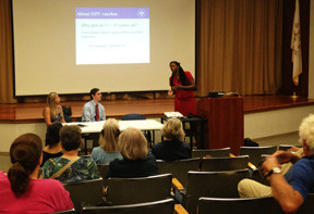 Dr. Nicole Alexander-Scott, director of the R.I. Department of Health, answers questions at a listening session about the HPV vaccine before some 35 people at the Barrington Library.