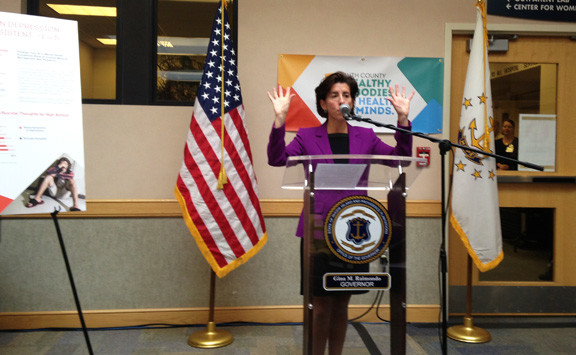 Gov. Gina Raimondo helps to launch the South County Healthy Bodies, Healthy Minds health equity zone at a news conference on Oct. 9 at South County Hospital.