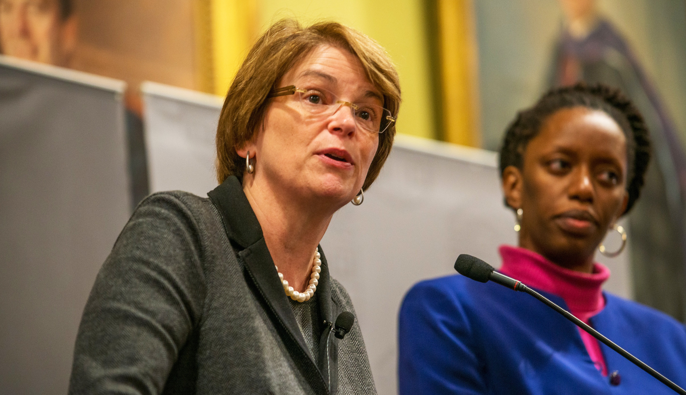 "Brown University President Christina Paxson, left, and Dr. Nicole Alexander-Scott, sharing the podium at the 2015 Levinger lecture, focused on ""unpacking"" racial disparities in health."