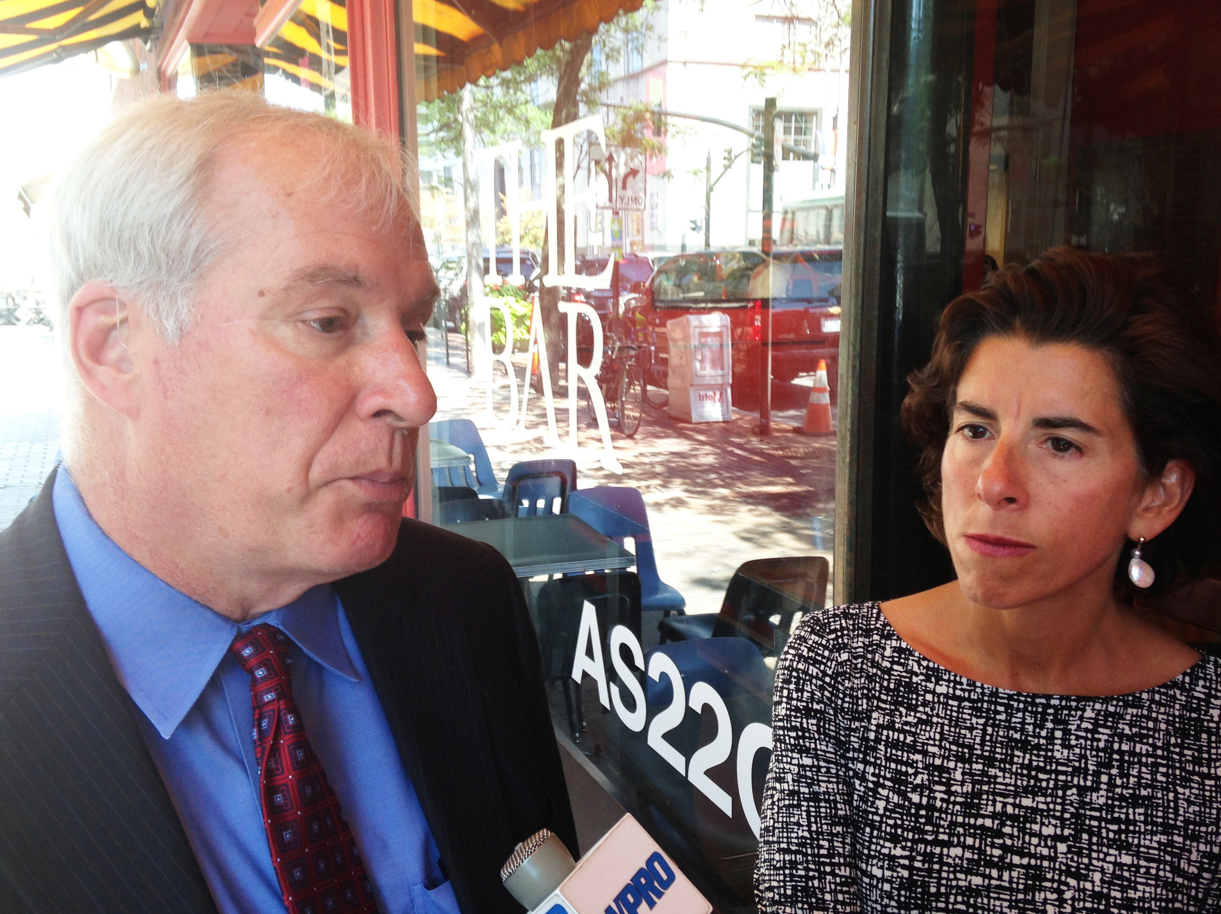 Eric S. Rosengren, president and CEO of the Federal Reserve Bank of Boston, left, and Gov. Gina  Raimondo, holding a media scrum outside of AS220 to discuss the Working Cities Challenge in Rhode Island.