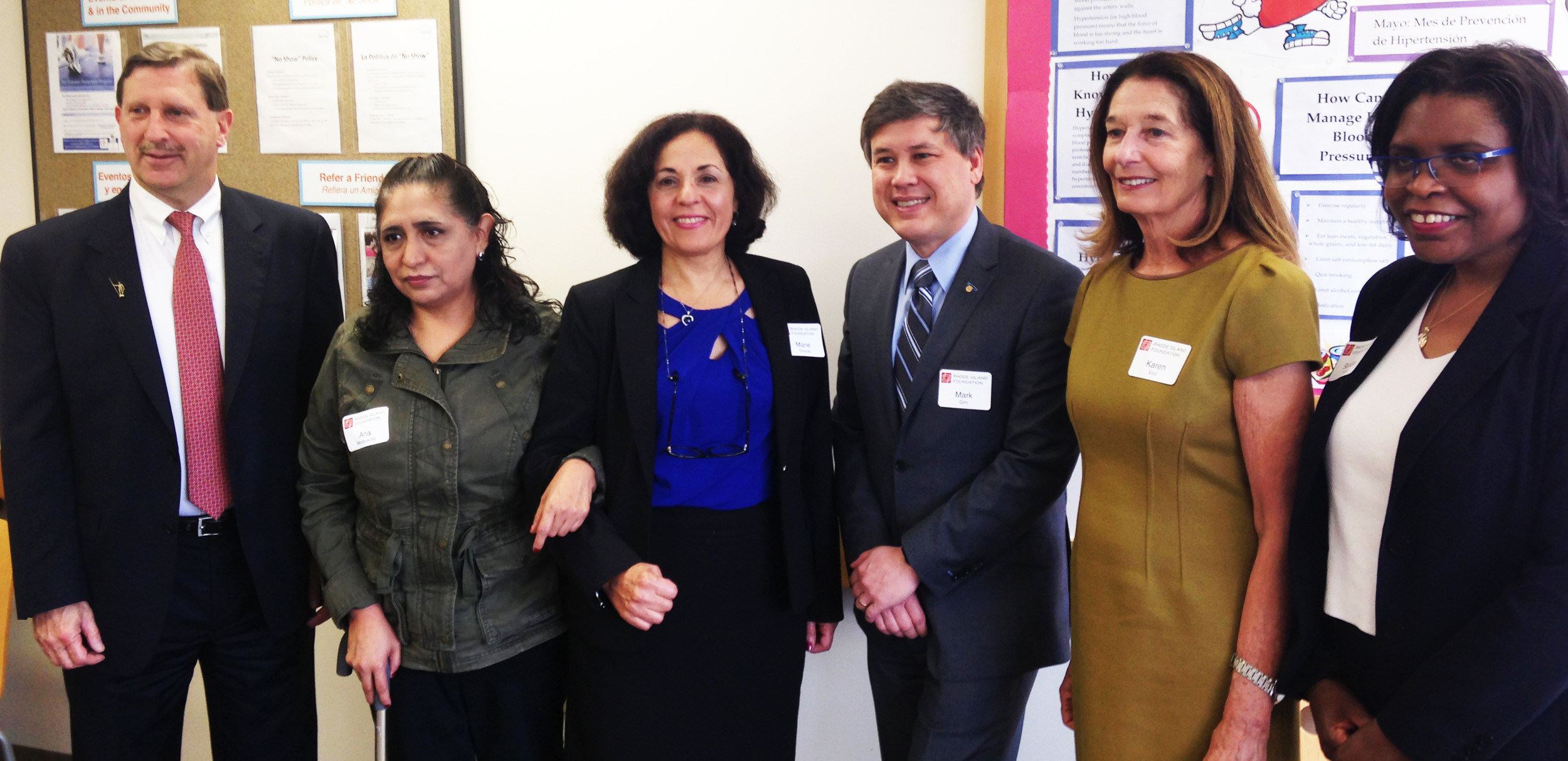 Neil Steinberg, left, president and CEO of The Rhode Island Foundation, Ana Morquecho, a R.I. Free Clinic patient, Marie Ghazal, CEO of the Rhode Island Free Clinic, Mark Gim, chair of the R.I. Free Clinic, Karen Voci, executive director at the Harvard Pilgrim Health Care Foundation, and Sandra Powell, associate director at the R.I. Department of Health, at the May 2 news conference, at which the Rhode Island Foundation announced more than $270,000 in grants.