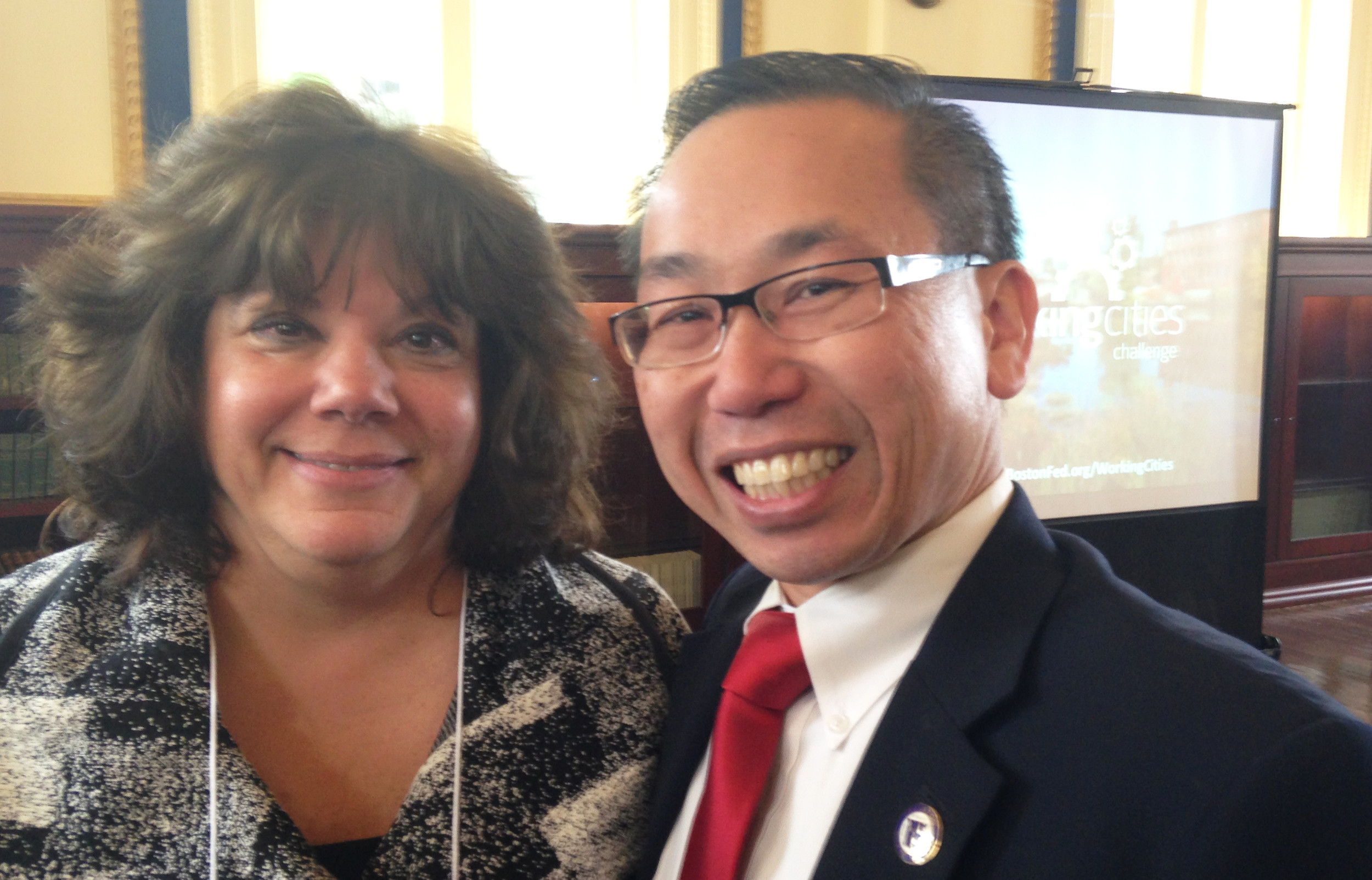 Cranston Mayor Allan Fung, right, with Joanne McGunagle, president and CEO of the Comprehensive Community Action Program, at the May 12 celebration of the Working Cities Challenge.