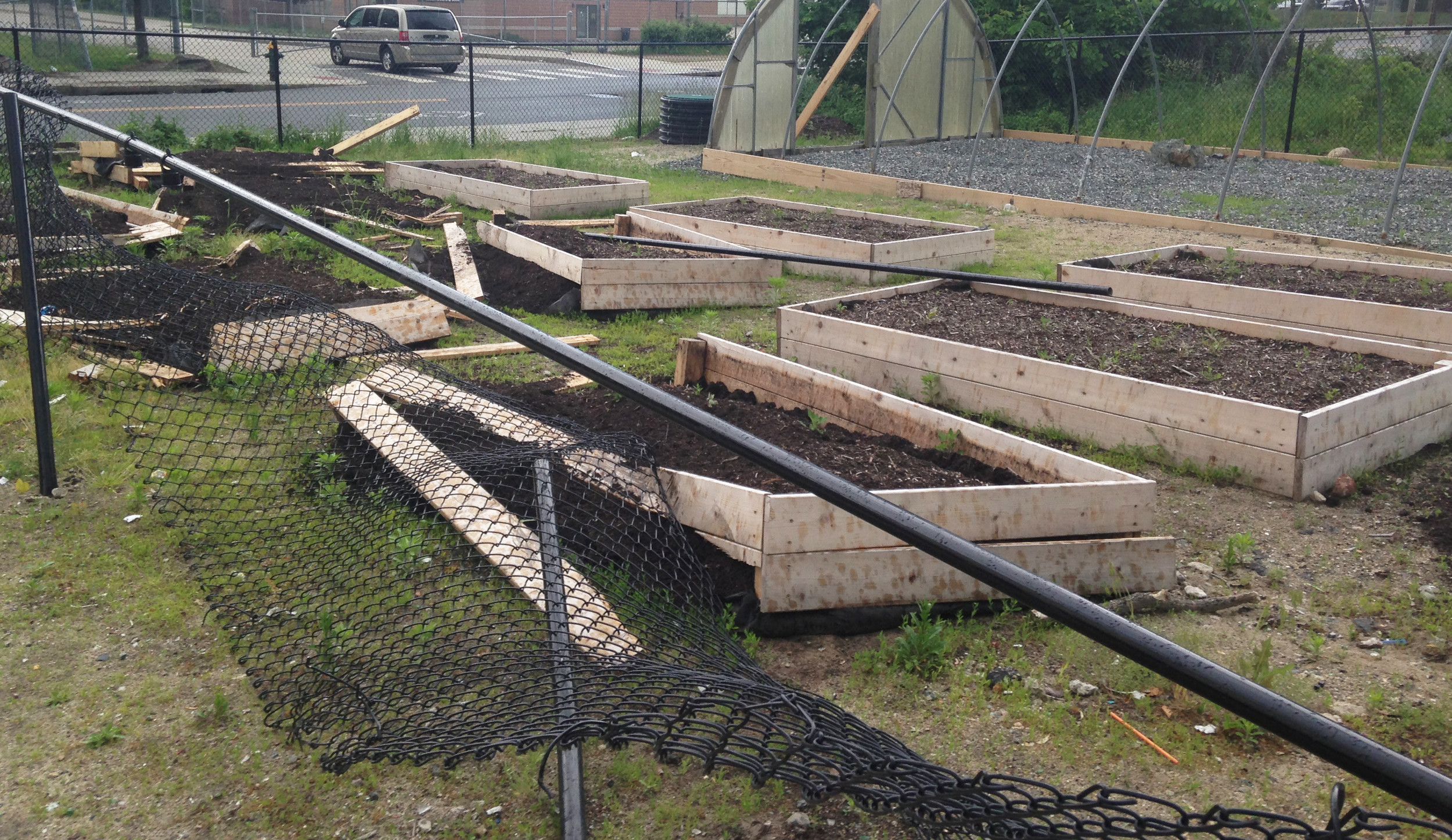A vandal drove a truck through the fence at the new urban farming site built by the African Alliance of Rhode Island, destroying 10 of 17 raised beds, a crime story unreported by the local news media.