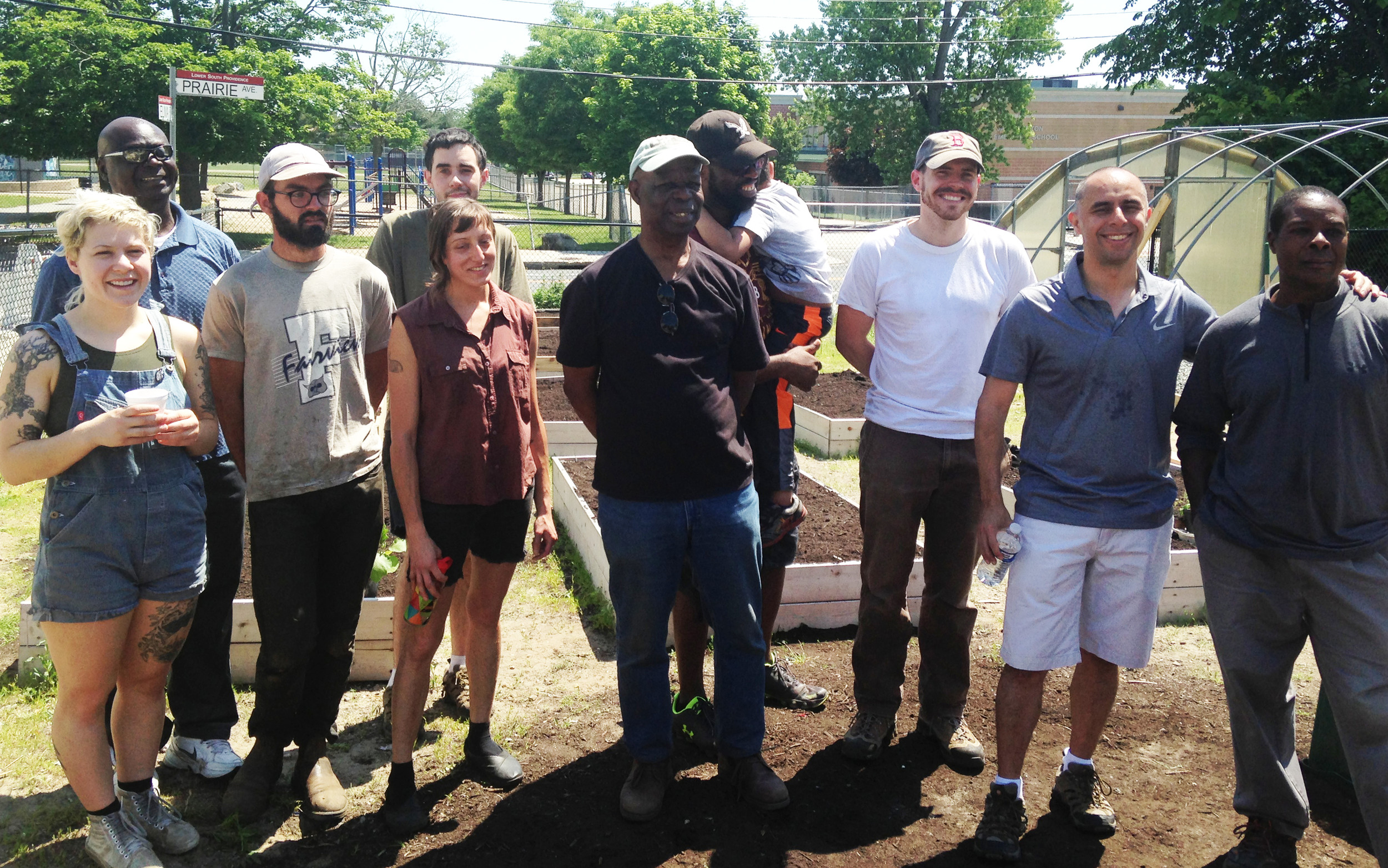 A crew of volunteers worked together to restore the damaged urban growing space on Saturday, June 10, a happy ending. Second from right: Providence Mayor Jorge Elorza, who pitched in to help. Julius Kolawole, center, is the president of the African Alliance of Rhode Island.
