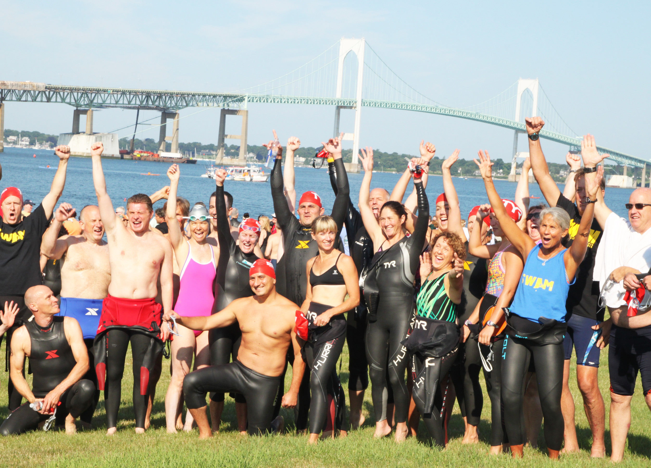 The swimmers who participated in the 2016 Save The Bay annual swim, celebrating its conclusion.