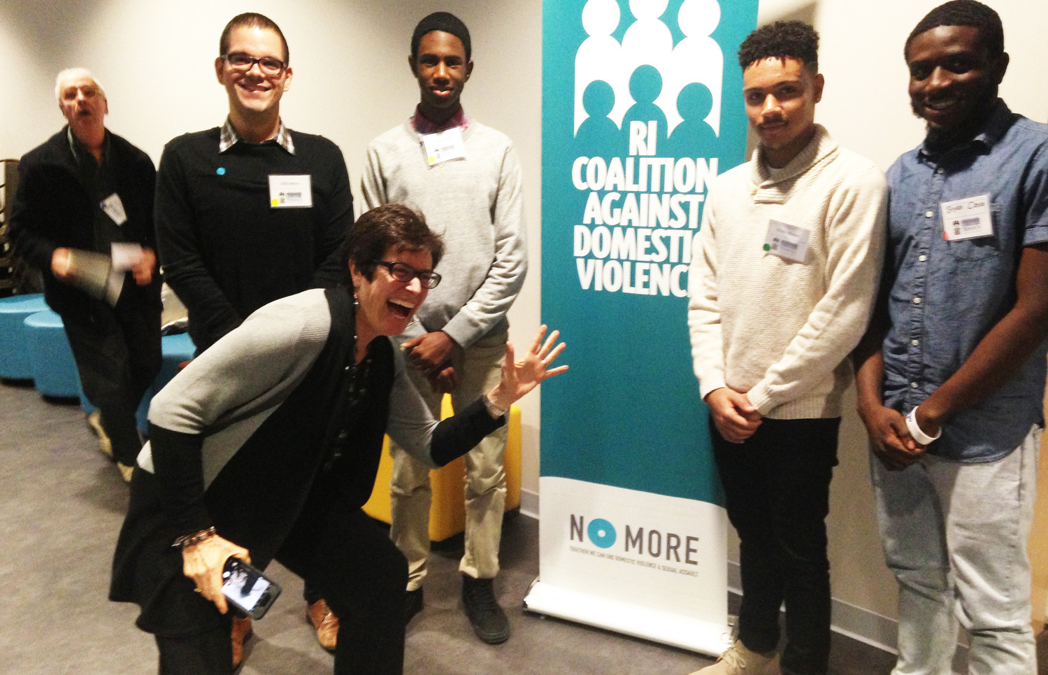 Deborah DeBare, executive director of the R.I. Coalition of Domestic Violence, photobombs a photo of students who attended the fourth annual Men's Summit: Breaking The Silence, on Nov. 9.