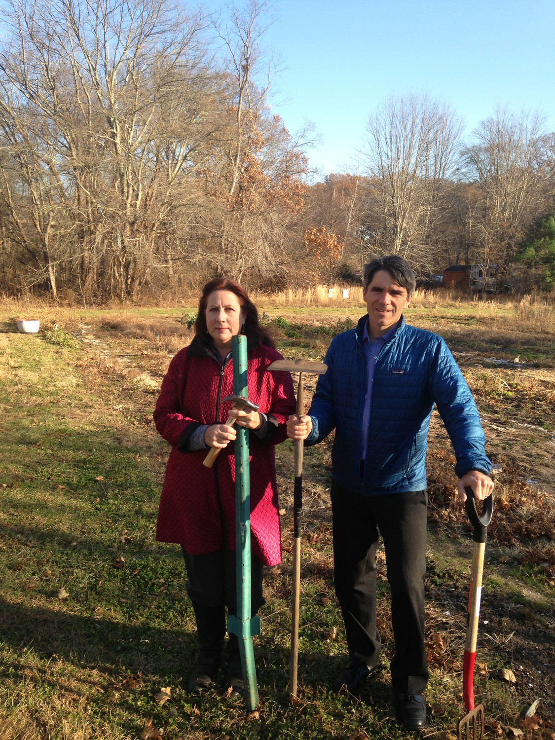 Tim Faulkner, right, and Candace Clavin, volunteers with the Barrington Farm School, at the site of the working farm they hope to buy and preserve.