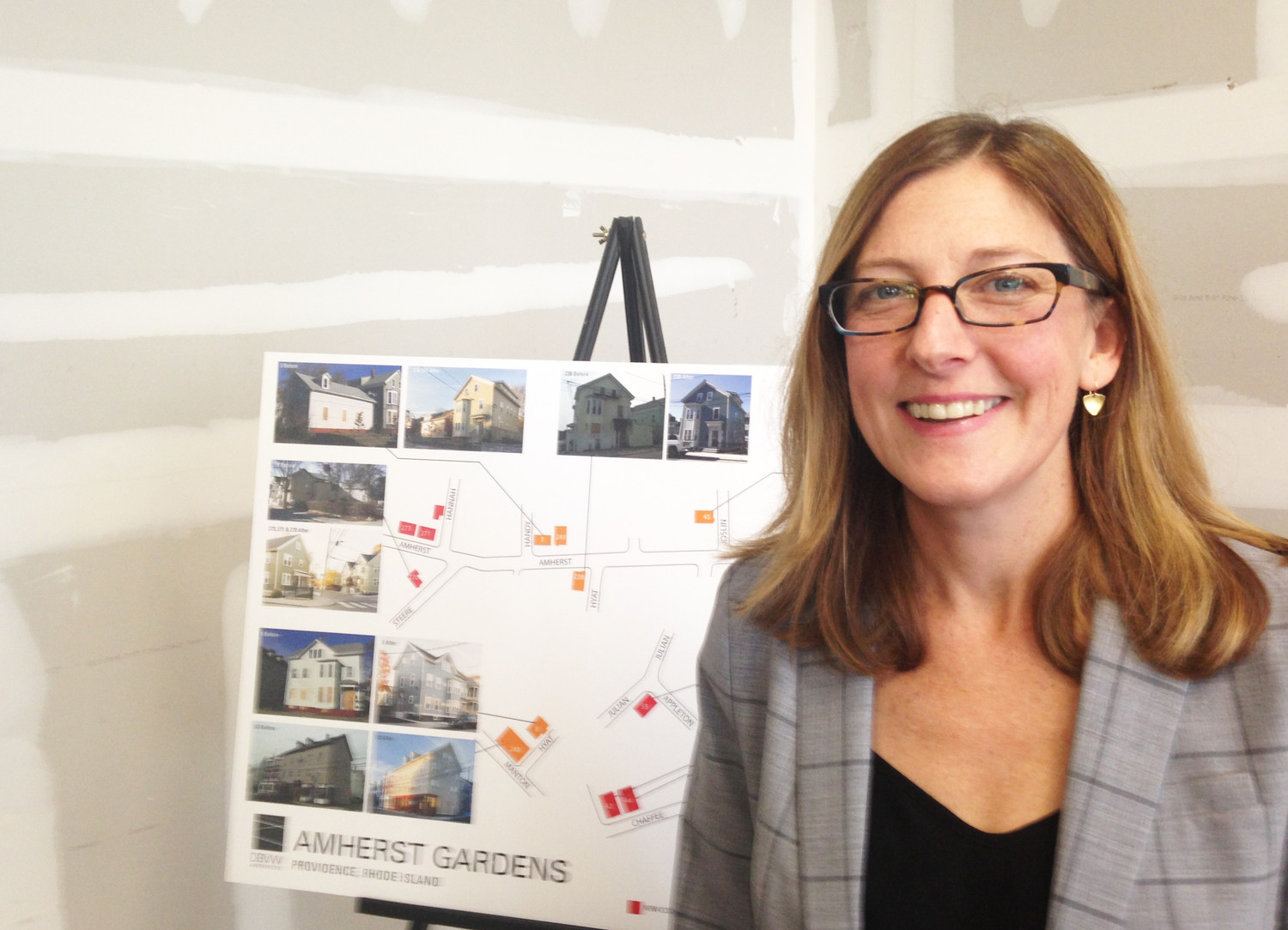 Jennifer Hawkins, the executive director of ONE Neighborhood Builders, at a recent event celebrating the completion of the Amherst Gardens project.