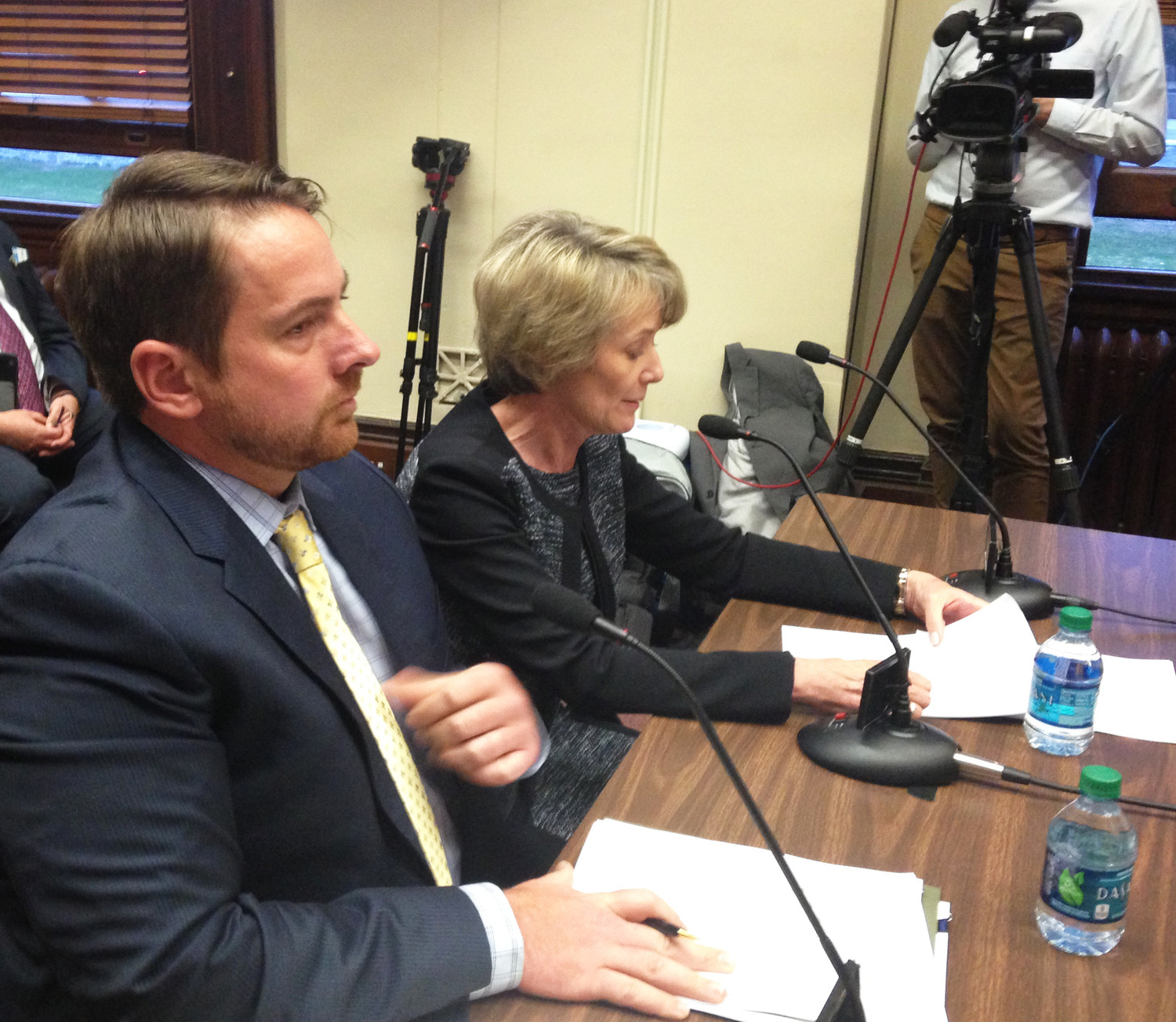 Kenny Smith, left, and Deborah Sills of Deloitte Consulting testify before the House Committee on Oversight on April 12.