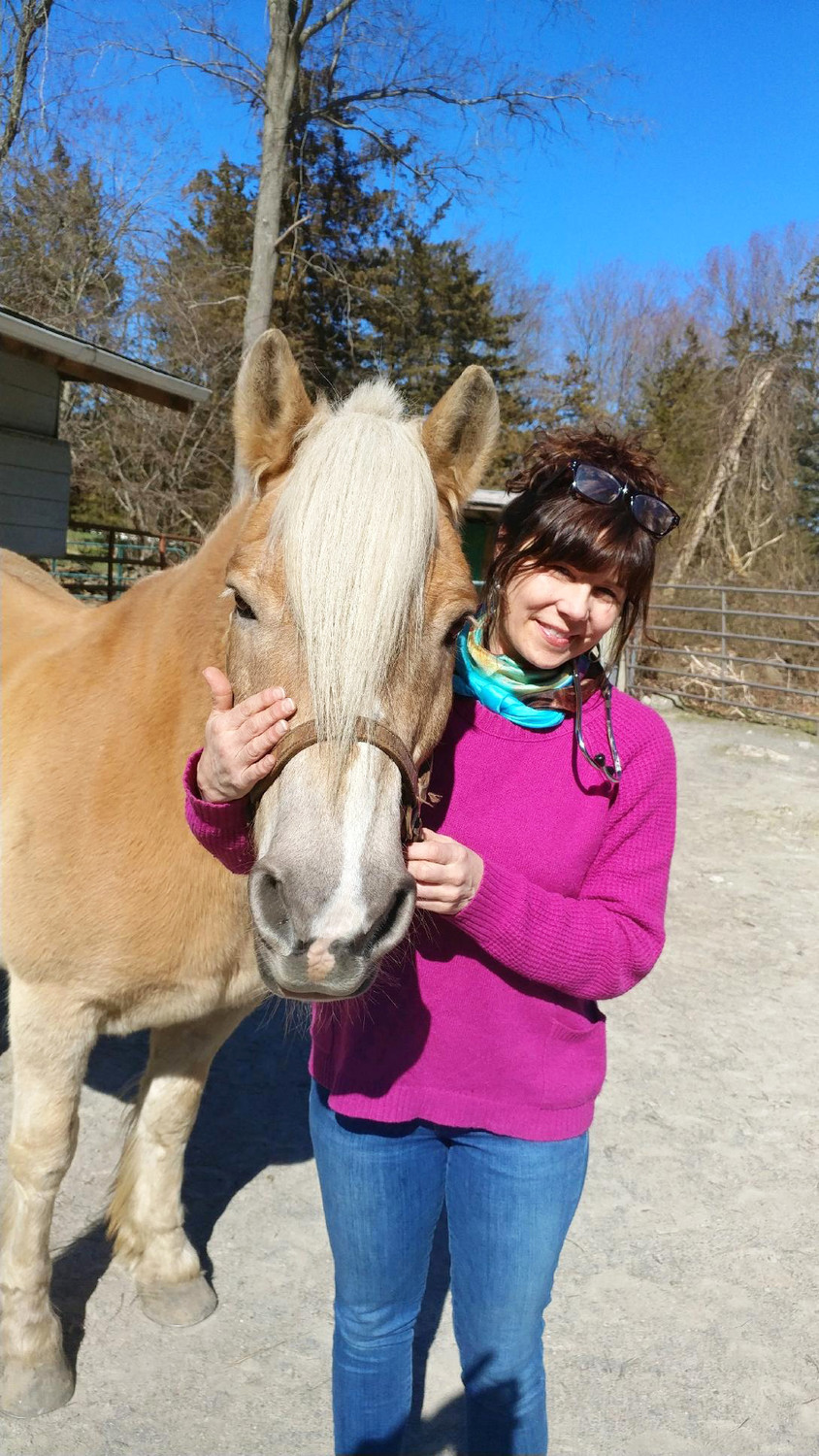Susan Fiske's physical therapy veterinary practice also involves working with horses.