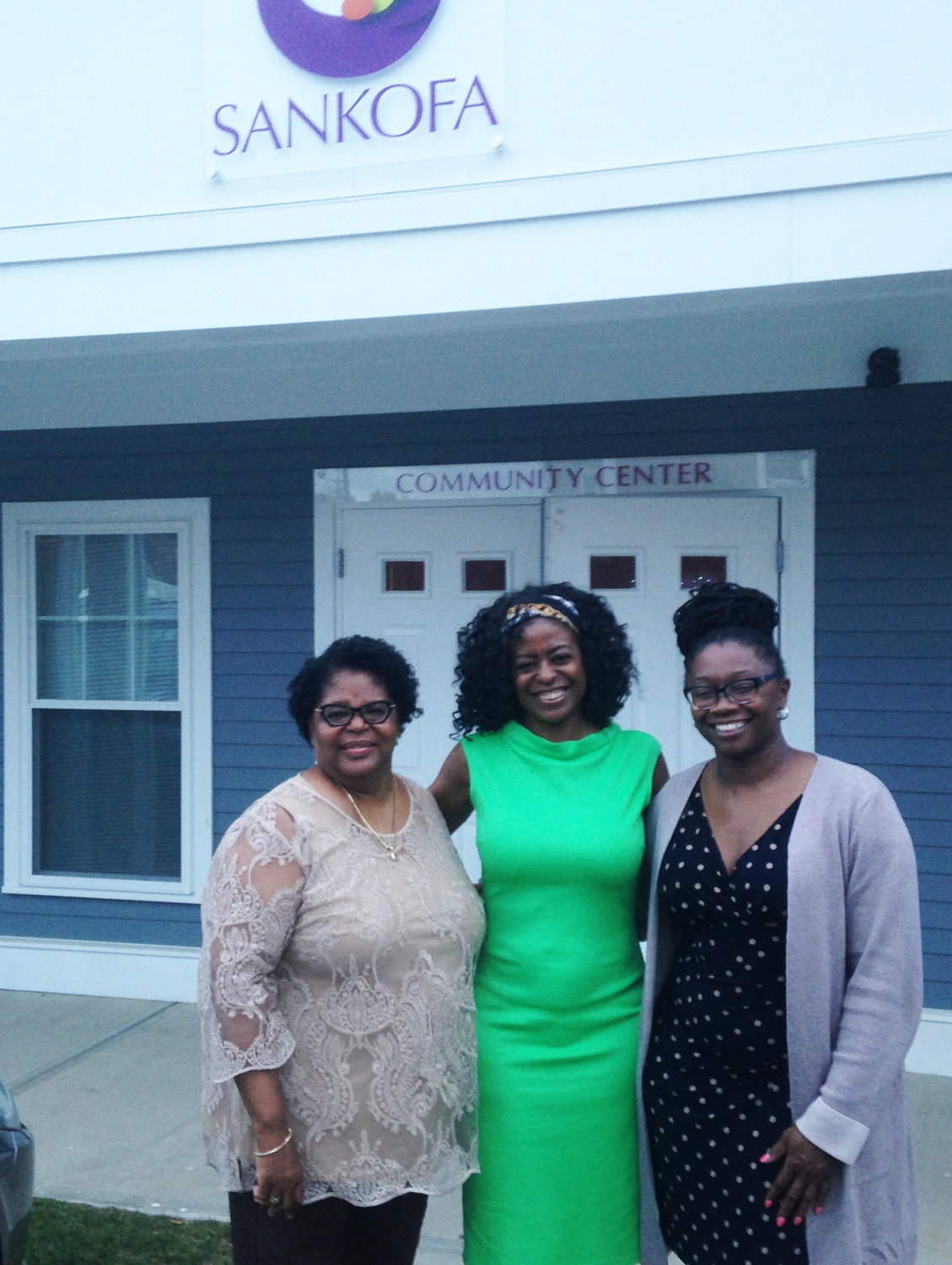 Sharon Conard-Wells, left, executive director of West Elmwood Housing Development Corporation, Gloria L. Johnson, center, West Elmwood board chair, and Angela Ankoma, right, at the Sankofa Eats! dinner on May 31.
