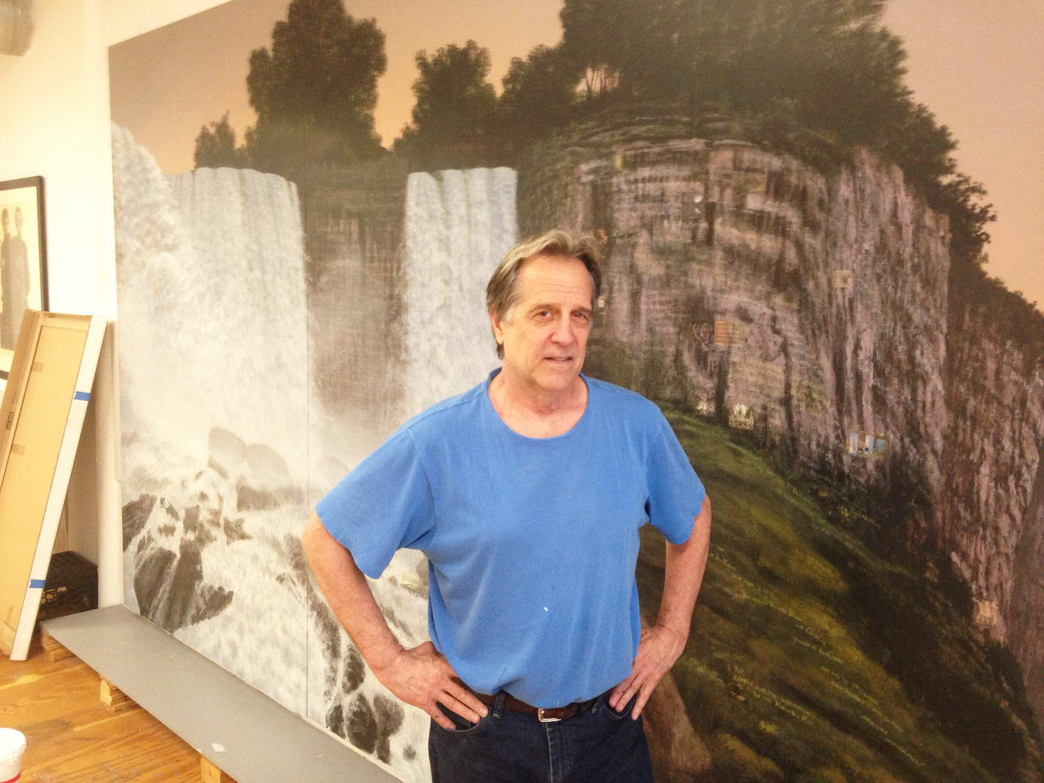 The artist Stephen Hannock in his studio in North Adams, Mass., in front of one his large natural landscapes.