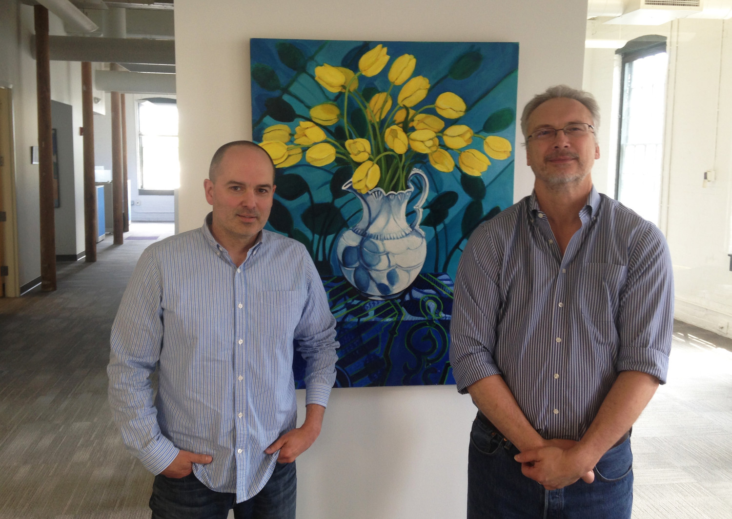 Clifford Grimm, left, and William Martin, of EpiVax, at the new office location in Olneyville.