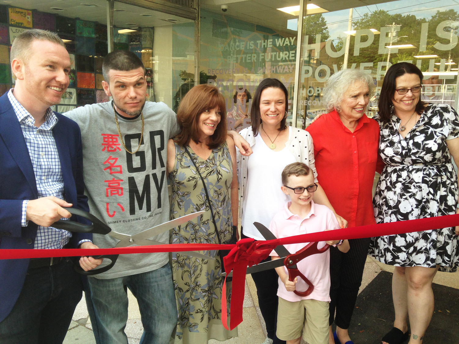 The family of Jim Gillen cuts the ribbon at the grand opening of the JIm Gillen Recovery Center.