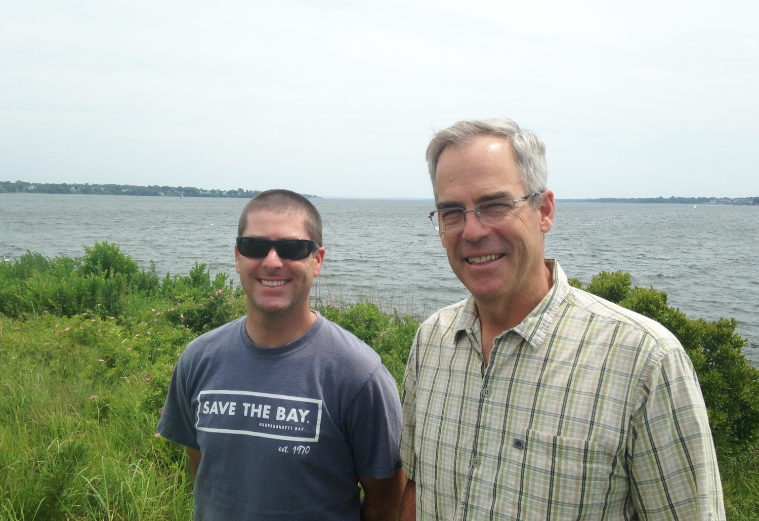 Baykeeper Mike Jarbeau and Executive Director Jonathan Stone outside Save The Bay headquarters in Providence.