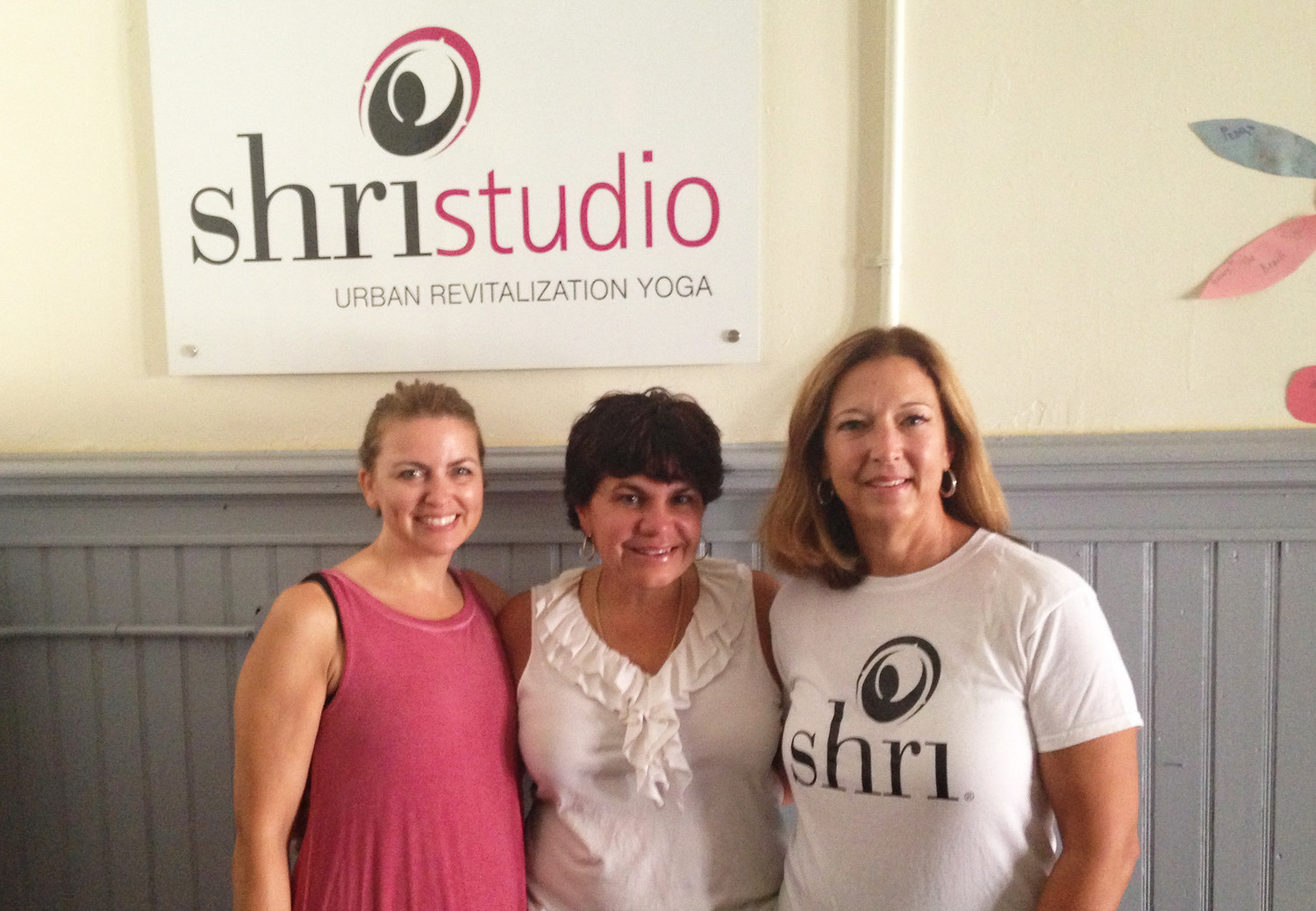 Charlene Breggia, left, instructor for the Yoga and Recovery class at Shri Yoga studio; Donna McDonald,a nurse who helped to set up the private yoga class for women from Eastman House, and Robin Sousa, right, a yoga instructor with Shri Yoga.