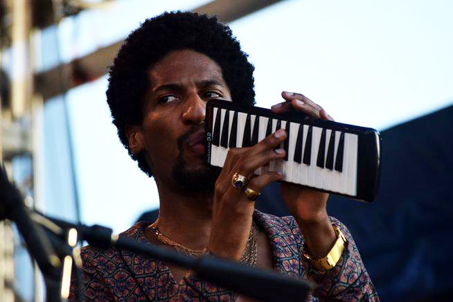 Jon Batiste performs at the 2018 Newport Folk Festival.