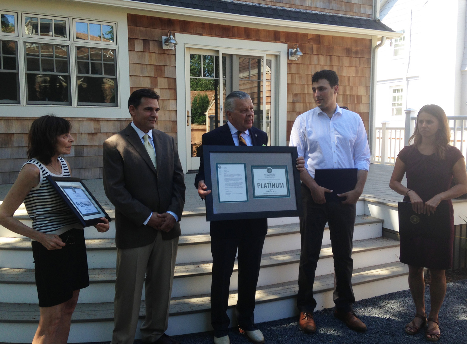 The award ceremony for the first Platinum LEED certified home in Rhode Island. From left, Felice Holt, homeowner, Richard Rodi, contractor, Kenneth J. Filarksi, chair of the of U.S. Green Building Council in Rhode Island, State Rep. Aaron Regunberg, and Providence Office of Sustainability director Leah Bamberger.