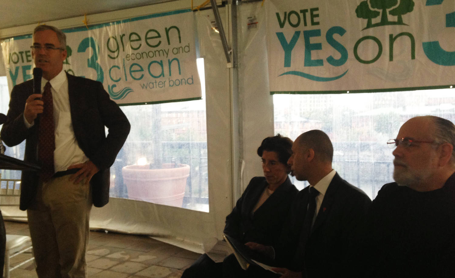 Jonathan Stone, left, executive director of Save The Bay, kicks off the Yes on 3 campaign on Friday, Oct. 12, including comments by Gov. Gina Raimondo, second from left, Providence Mayor Jorge Elorza, third from left, and Barnaby Evans, the creative director of WaterFire.
