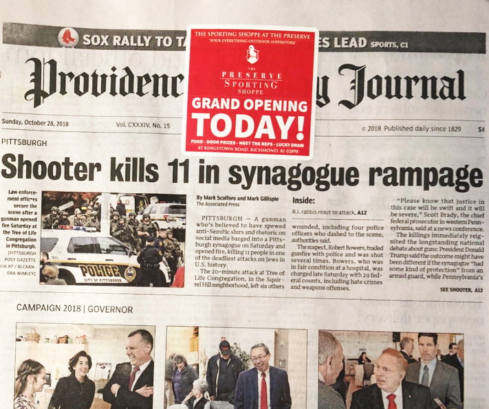 "A sticker ad for the grand opening of new shooting shop and indoor gun range appeared over the headline in the Sunday, Oct. 28, edition of The Providence Journal, ""Shooter kills 11 in synagogue rampage."